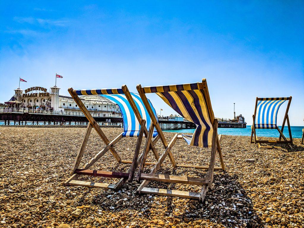Two deckchairs on Brighton beach